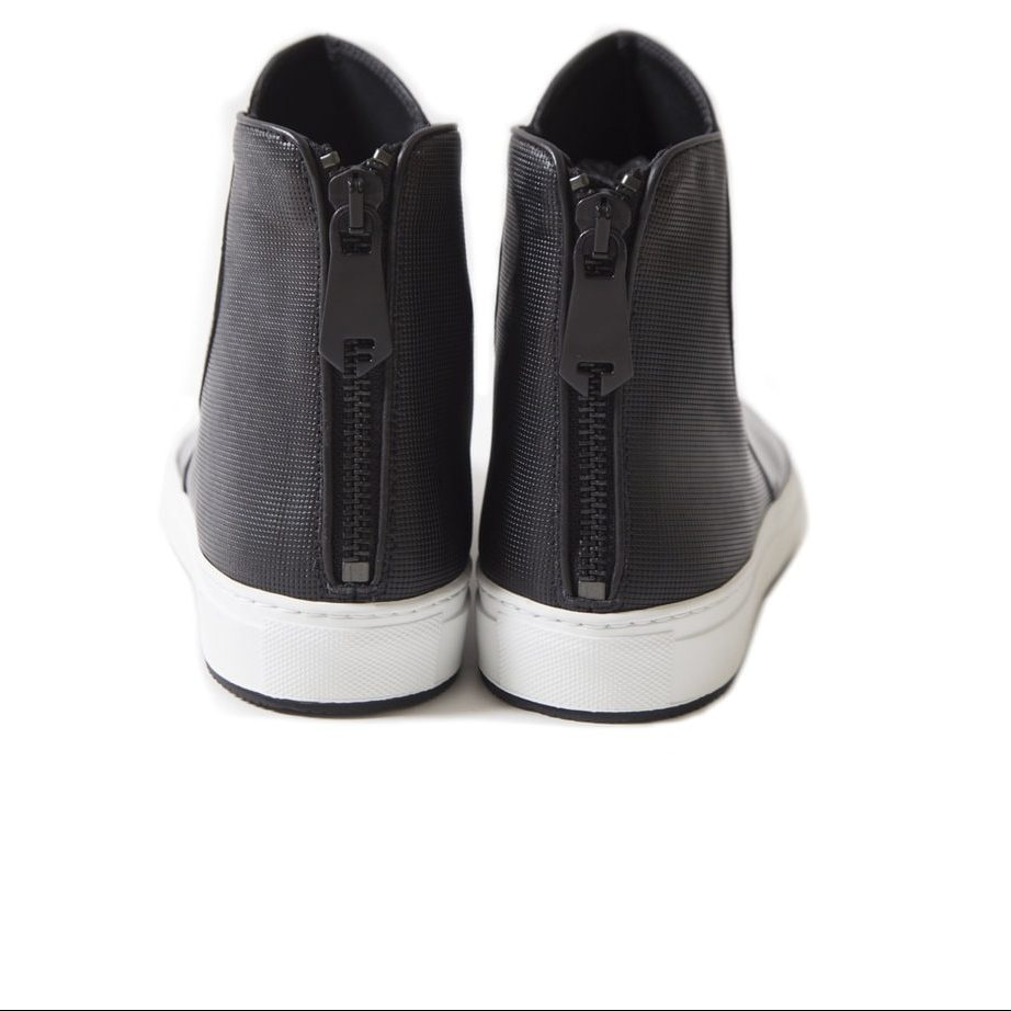 Black leather shoes with white sole